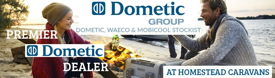 Premier Dometic Dealer first choice for Dometic, Waeco and Mobilcool products - Image of Man and Woman outdoors with Dometic fridge